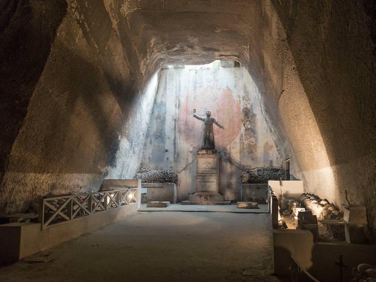 Explore an eerie underground cemetery in Naples