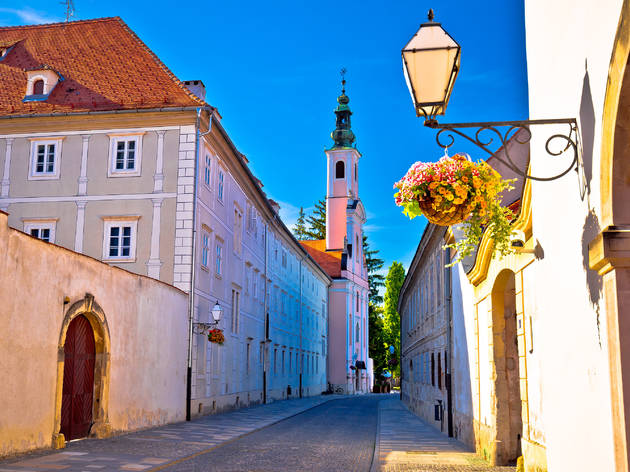 Lamp sconces graced with flowers among Baroque architecture in Varaždin city