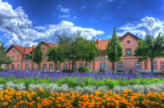 The manicured lawn of Bjelovar city's 19th-century railway station