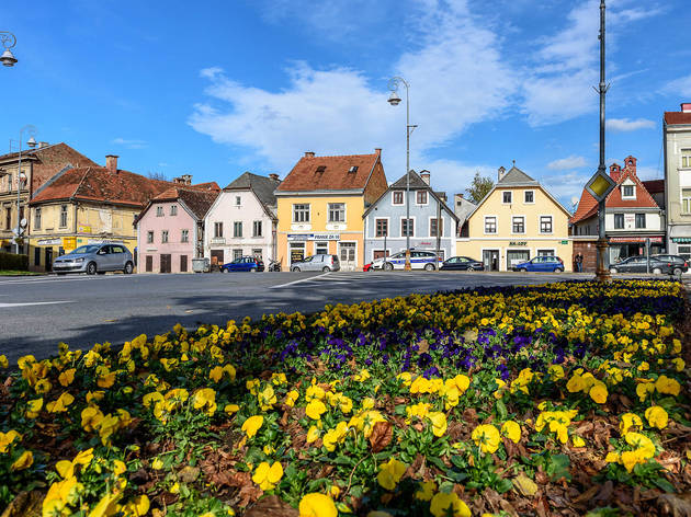 Pastel-coloured houses and flowers in Karlovac's city centre