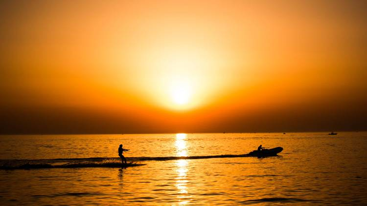 Water ski (it's even better at sunset!)