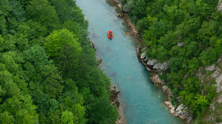 Go rafting on a crystal-clear river