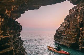 Kayak through a cave