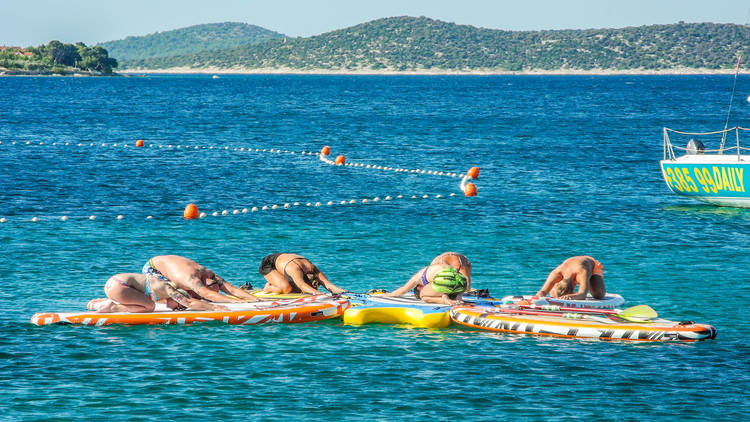 Try out paddleboard yoga