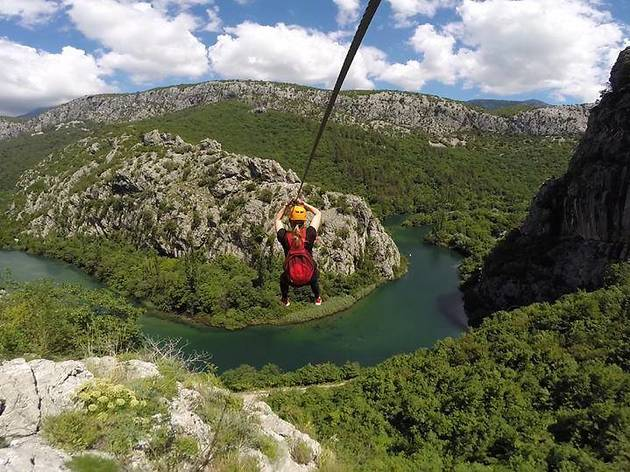 Zipline over a winding river