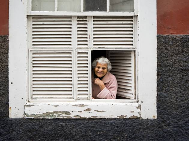 Older woman leaning out of window