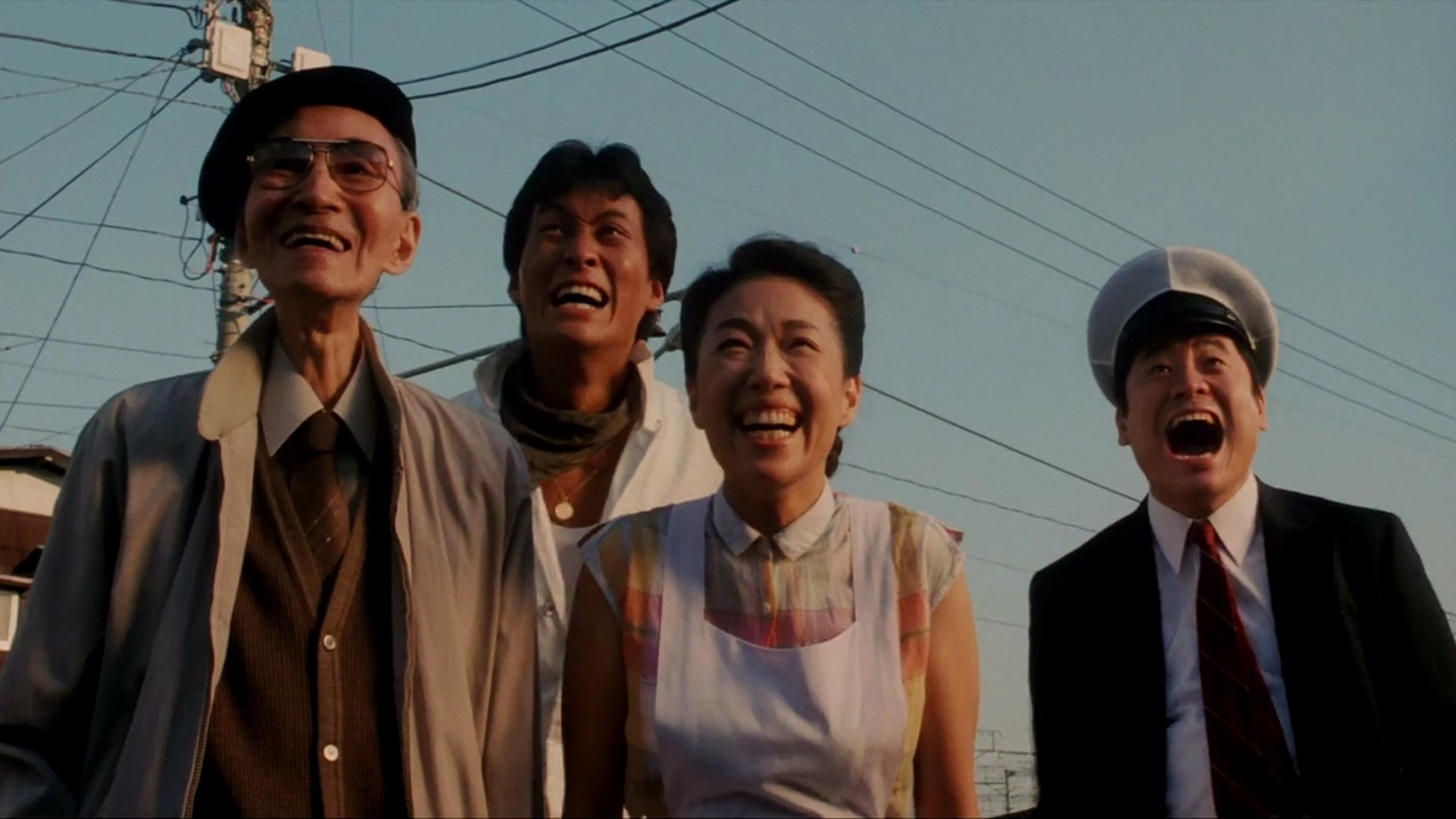 Four people laughing