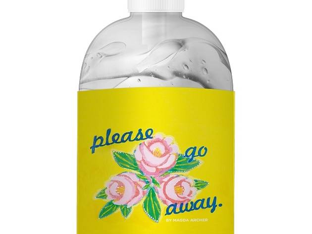 A pump bottle of hand sanitiser with a label on it that has roses and 'please go away'