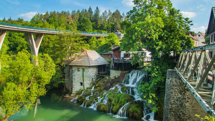 Korana river winding through central Croatia's town of Slunj