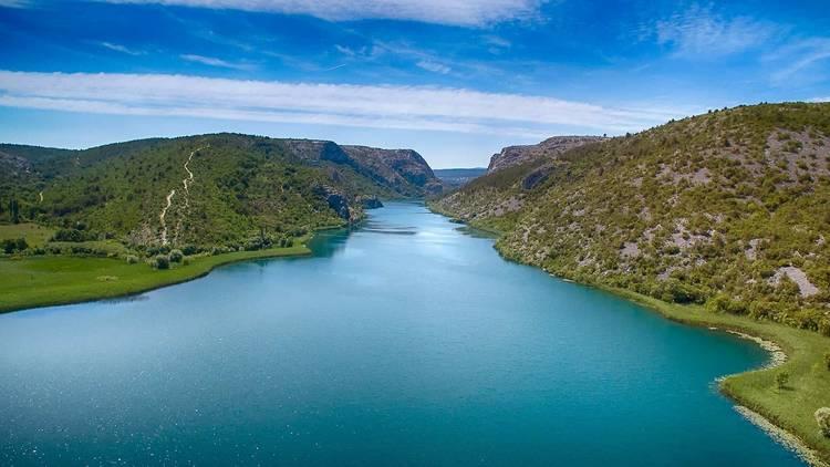 Krka river gently sloping through Dalmatian hills