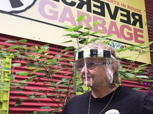 Woman wearing a face shield outside Reverse Garbage