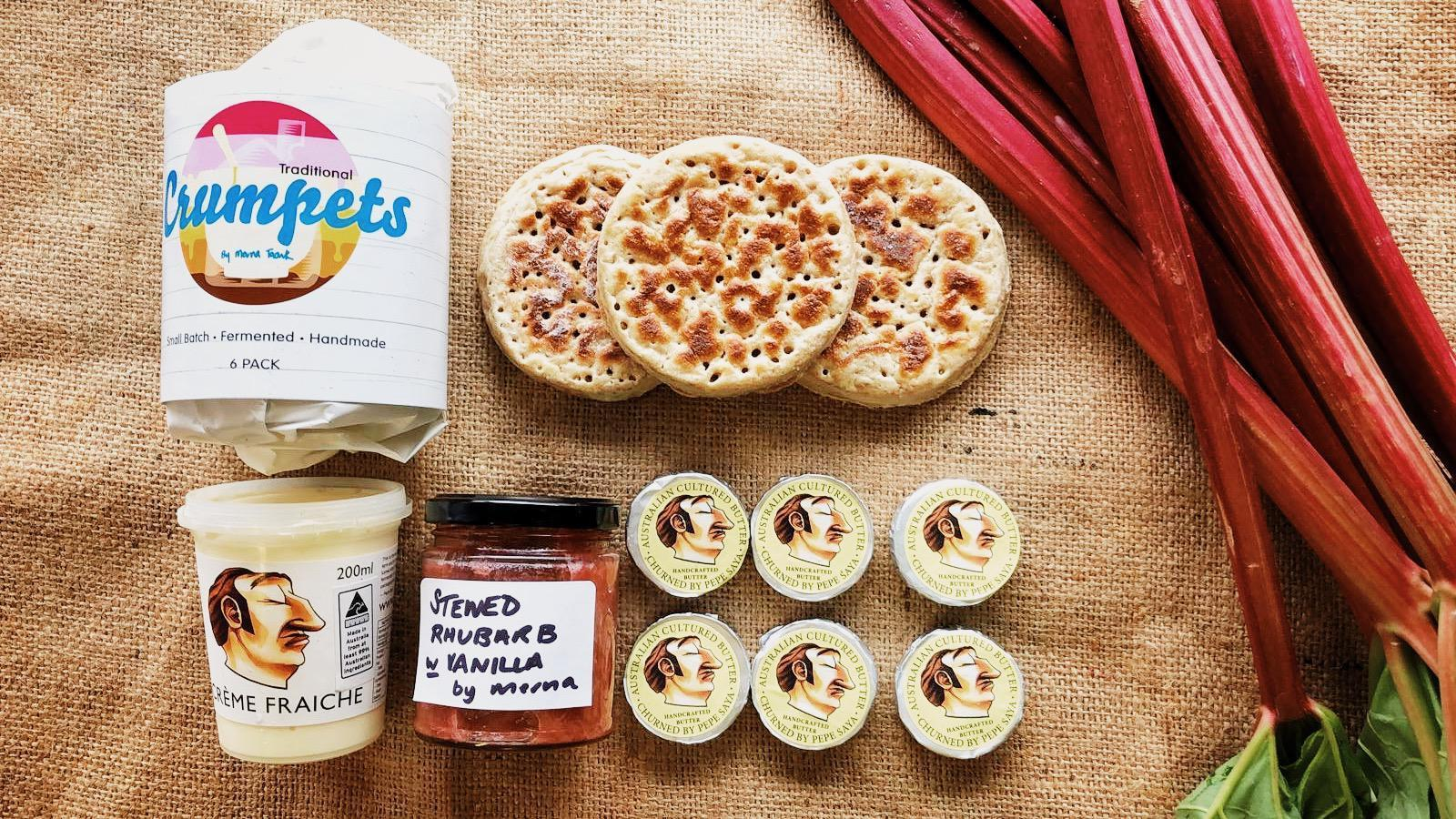 Crumpets, Pepe Saya butter and jars of condiments in a flat-lay