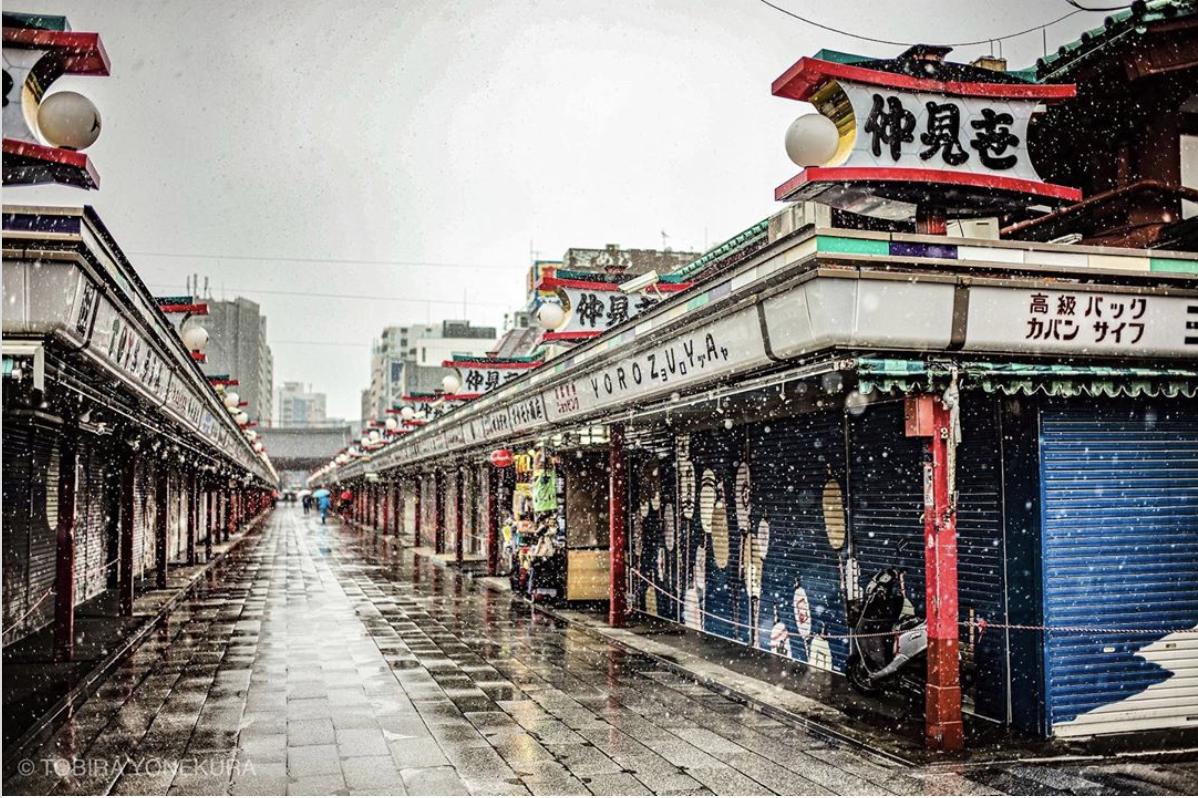 Sensoji Temple walkway is empty as snow falls