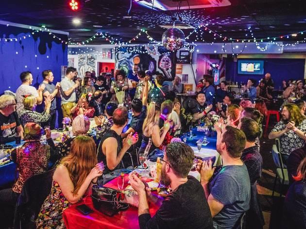 Room of people enjoying a drag night