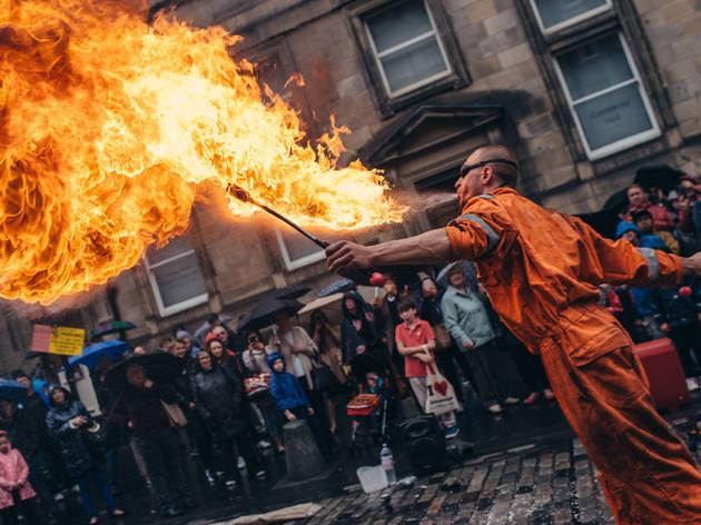 A fire-eating performer at Edinburgh Festival Fringe