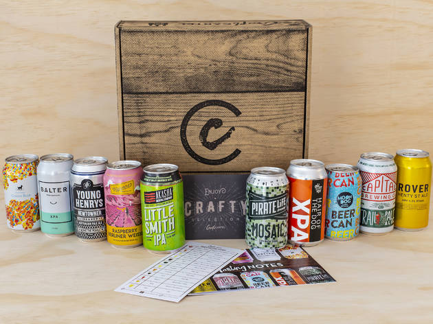 Ten tins of craft beer unpacked from a box.