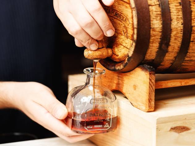 Patron being poured out of a barrel