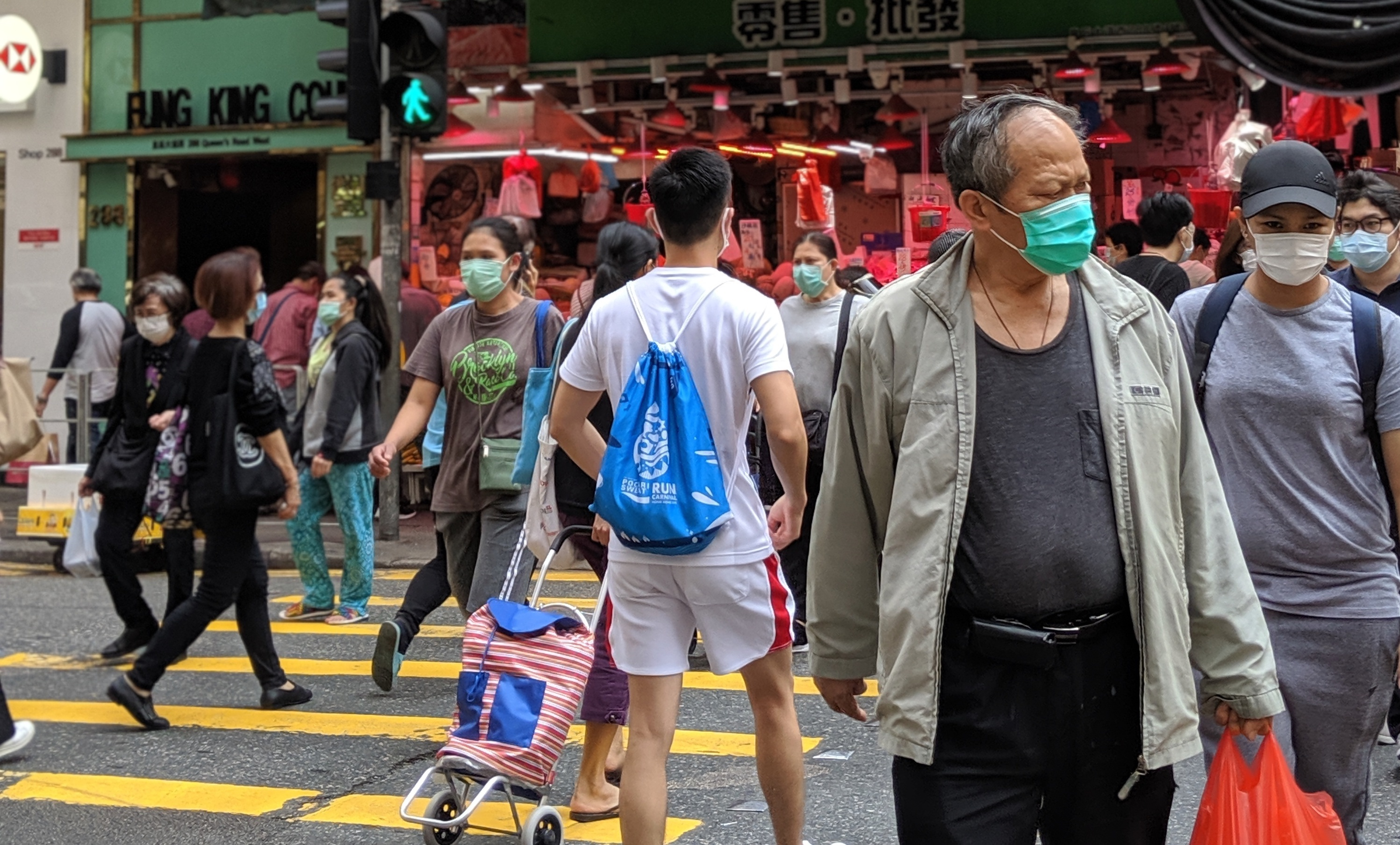 pedestrians crossing the road in Sai Ying Pun