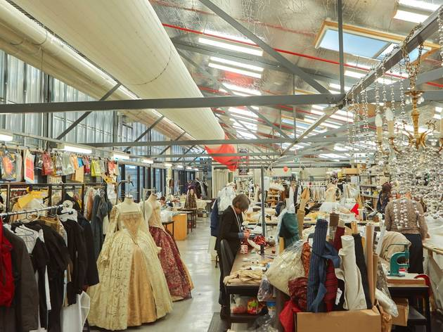 A warehouse-style room filled with costumes and fabric