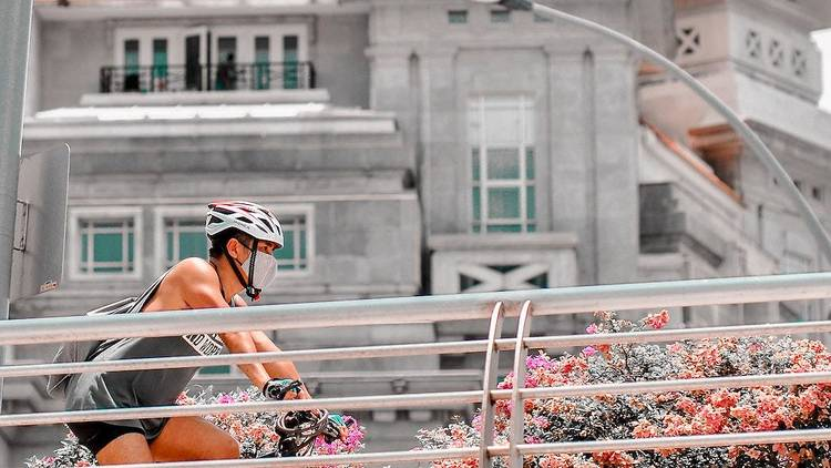 man cycling in CBD with mask