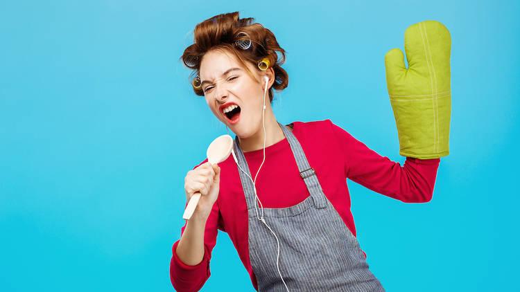 Cute girl sings songs in spoon listening to music