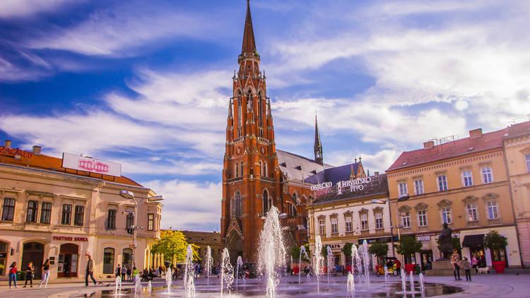 Osijek / Croatia: 10th May 2019: Main town square and famous cathedral in Osijek