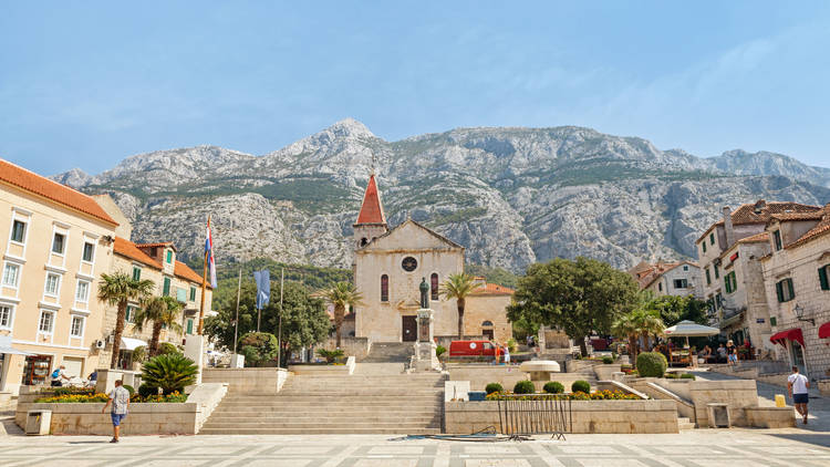 The Kačić square, Makarska's biggest, is backed by the towering Biokovo mountain range