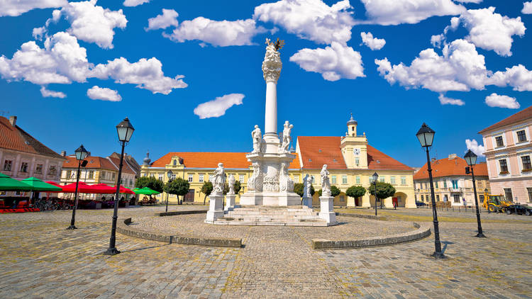 Osijek's Holy Trinity square surrounds a 1729 monument flanked by statues of St. Roch, St. Sebastian, St. Catherine and St. Rosalia