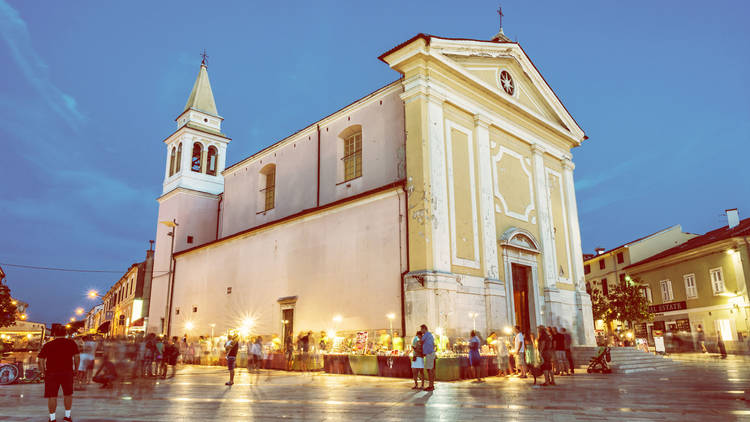 Lady of Angels Church, tourists and markets with souvenirs, Pore