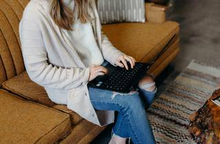 Woman using laptop on couch