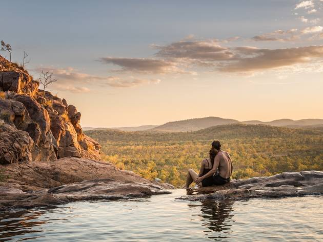 Couple sitting at Gunlom Falls, Kakadu