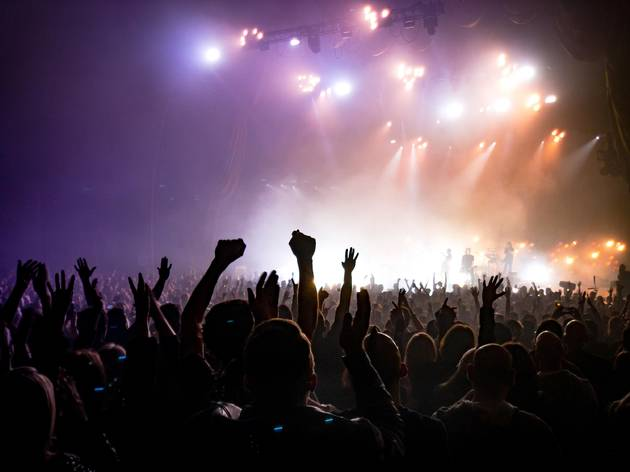 Crowd at a concert, with lights and smoke