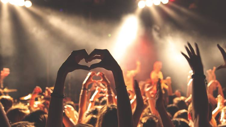 Hand making heart gesture at concert