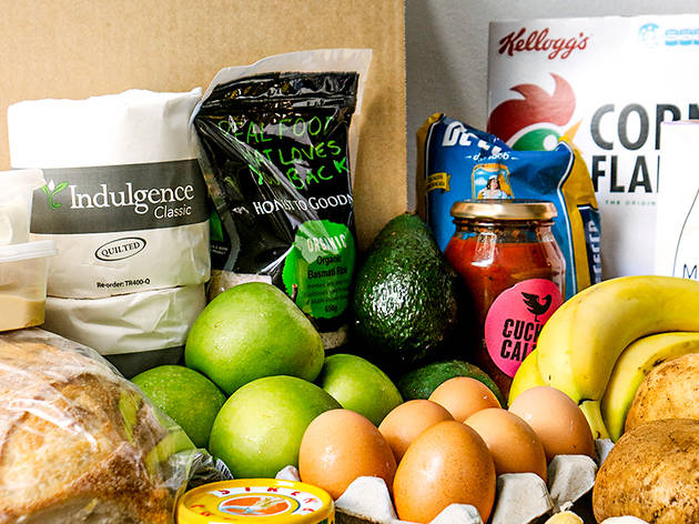 An unpacked box of produce and pantry staples