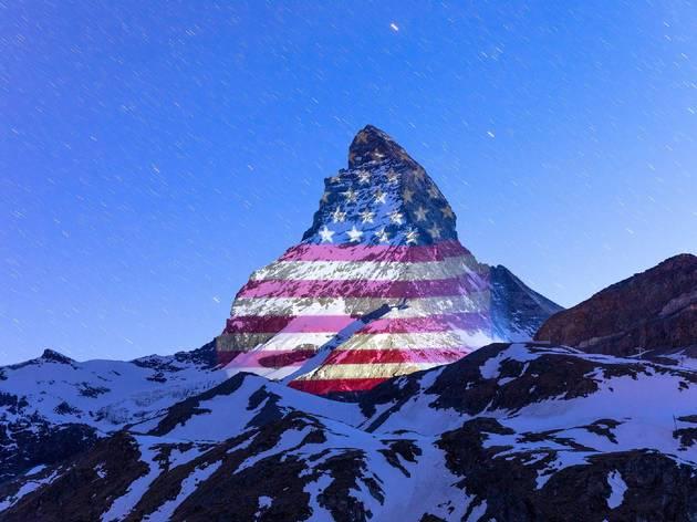Matterhorn lit up with US flag