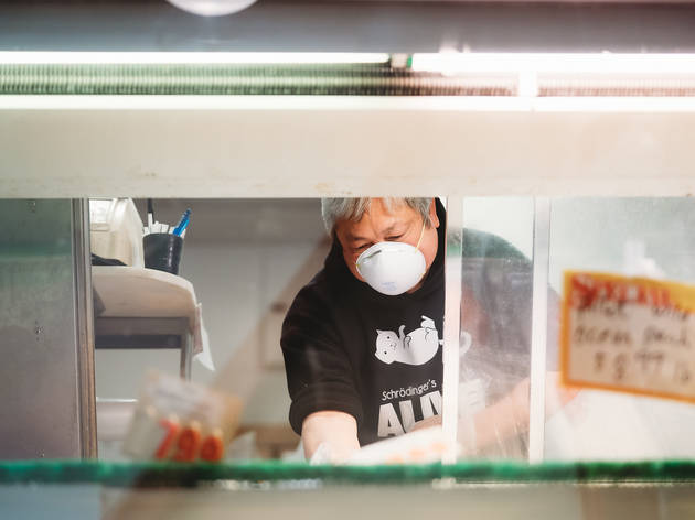 sincere seafood owner wearing mask
