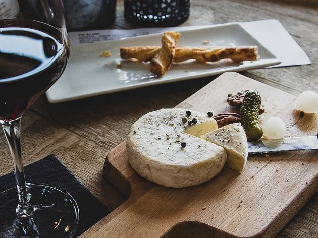Cheese board and glass of red wine