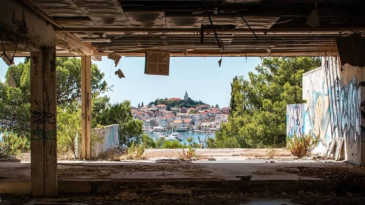 Primošten peeks out from the ruins of 20th-century Hotel Marina Lučića, thought to have owned Europe's first nudist beach