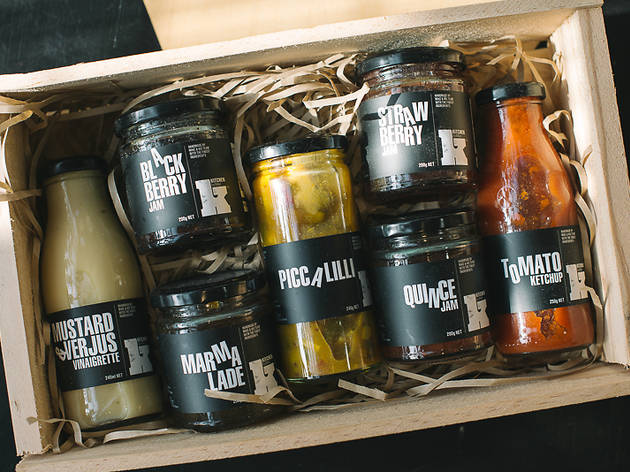 A box of jarred condiments like ketchup and piccalilli from Kitchen by Mike