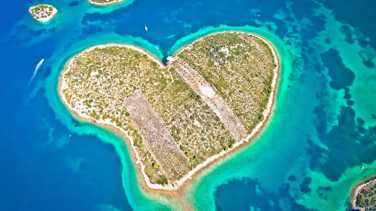 Heart shaped island of Galesnjak in Zadar archipelago aerial vie