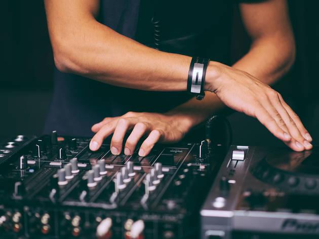 DJ's hands control the remote control close-up