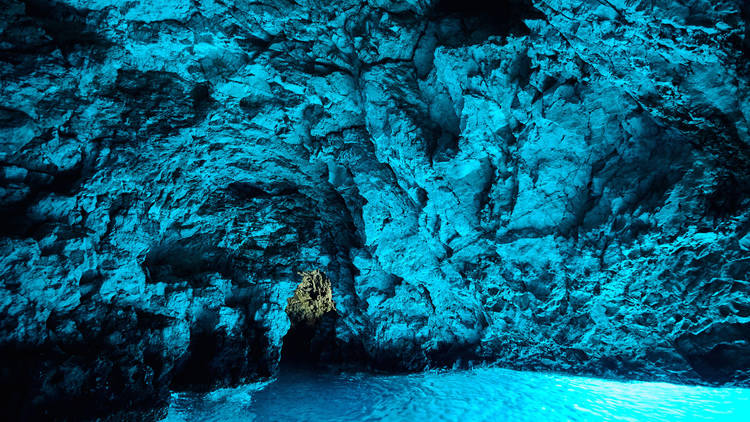 Bleu cave in Croatia, Croatian wonder, landmark. inside of the Blue cave, Bisevo island, light of blue color from water at midday