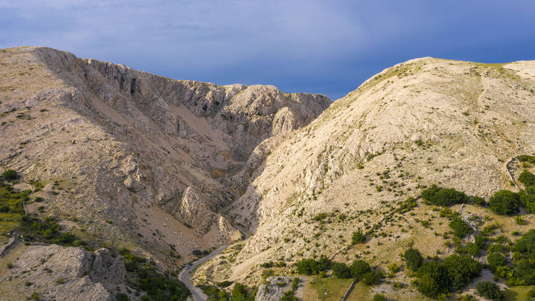 The Croatian coast can go from bright blue and green to arid quickly - like on Krk island, pictured