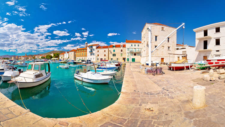 Kastel Novi turquoise harbour and historic architecture panoramic view, Split county