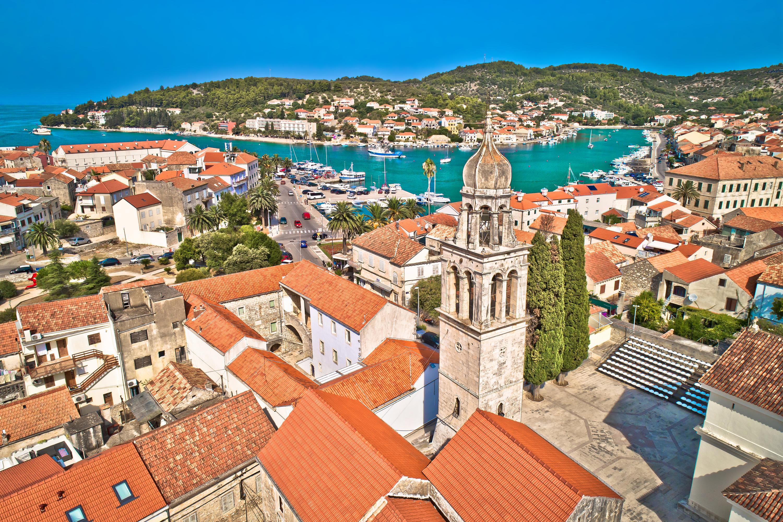Town of Vela Luka on Korcula island church tower and coastline a