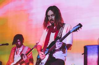 Frontman of Tame Impala with guitar