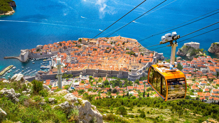 Aerial panoramic view of the old town of Dubrovnik with famous Cable Car on Srd mountain