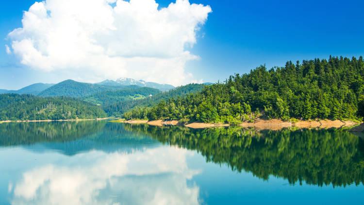 Croatian mountain landscape, region Gorski kotar, Lokvarsko lake with Risnjak mountain in background