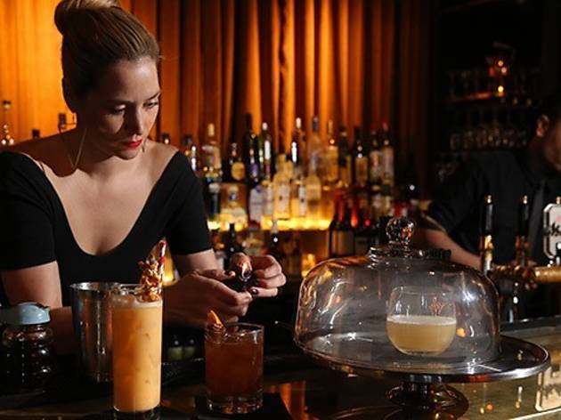 Woman pouring cocktail