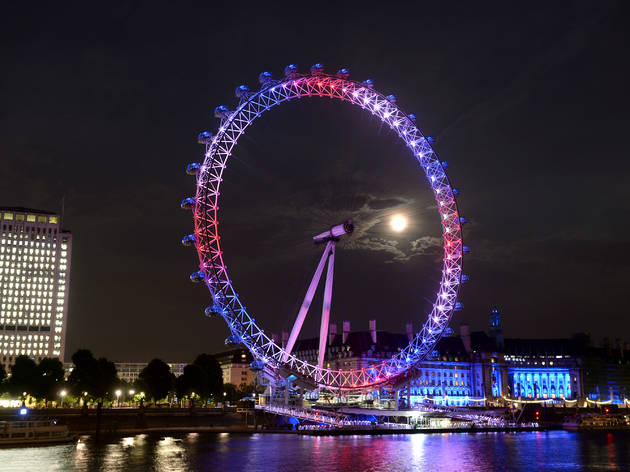 The EDF London Eye celebrates the birth of the Duke and Duchess of Cambridge's son and future King by lighting up red, white and blue, South Bank, London.Photo Credit should read Doug Peters EMPICS Entertainment